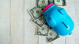 Americans' saving habits improve, slightly